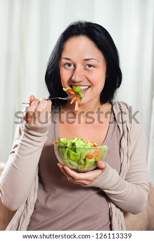 Young beautiful woman eating salad,Healthy meal - stock photo