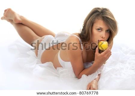 Young beautiful woman eatting a sweet apple - stock photo