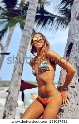 Young beautiful woman enjoying freedom on a tropical island - stock photo
