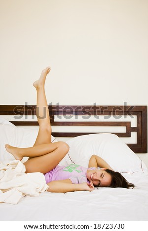 Young beautiful woman enjoying her waking up.