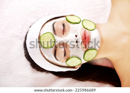 Young beautiful woman enjoying spa - stock photo