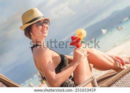 young beautiful woman enjoying summer vacation, beach relax, summer in tropics - stock photo