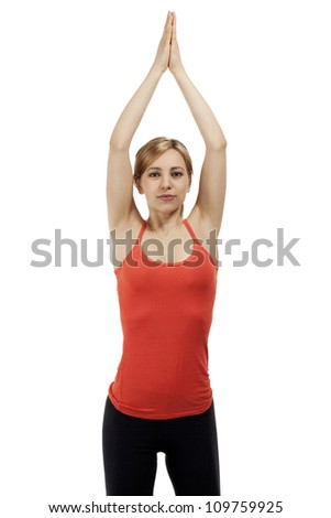 young beautiful woman exercising yoga with her arms over her head on white background