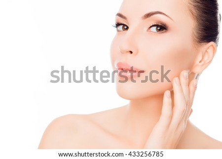 Young beautiful woman expertising skin on her face - stock photo