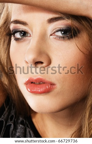 Young beautiful woman face portrait with all skin details preserved - stock photo