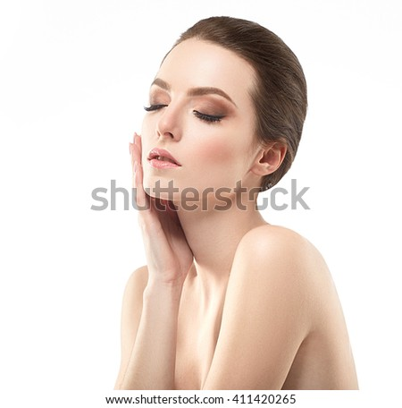 Young beautiful woman face portrait with healthy skin closed eyes touching face