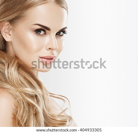 Young beautiful woman face portrait with healthy skin long curly blonde hair - stock photo