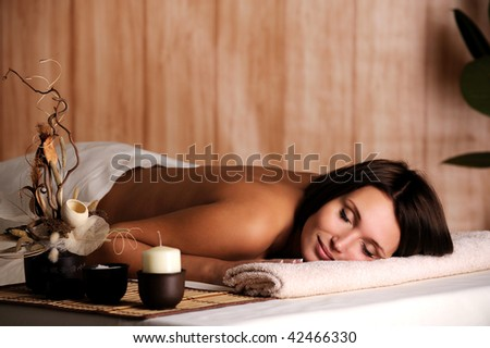 Young beautiful woman get relax in the spa salon