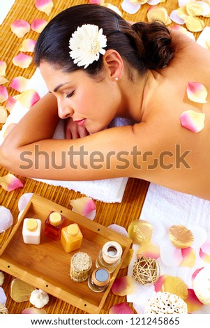 Young beautiful woman getting massage in spa salon.