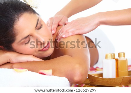 Young beautiful woman getting massage in spa salon. - stock photo