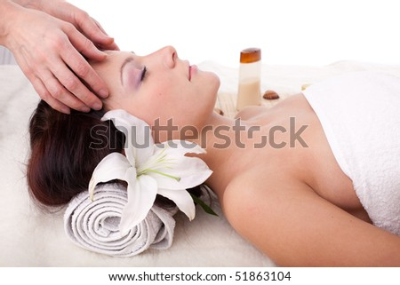Young beautiful woman getting spa treatment  on a  white background - stock photo