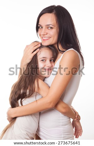 Young beautiful woman girl mother sister with her cute daughter child kid