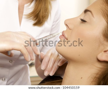 young beautiful woman having an injection mesotherapy - stock photo