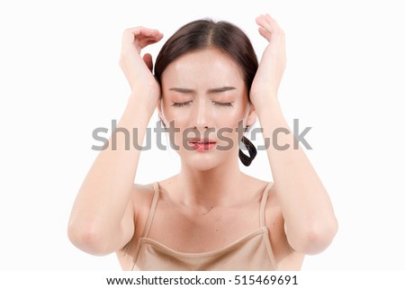 Young beautiful woman having headache migraine from depression, stressed, tired and self massage on her temple. Isolated over white background, Natural makeup, 	Healthcare and medical concept.
