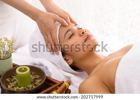 Young beautiful woman having shuatsu massage in the spa salon - stock photo