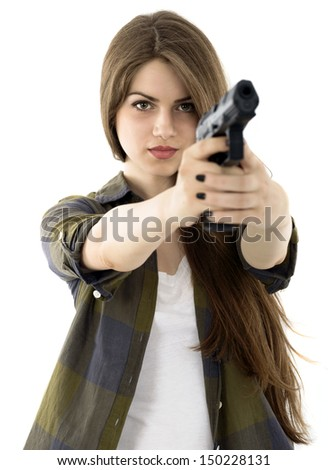 Young beautiful woman holding a gun on white background - stock photo