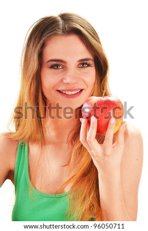 Young beautiful woman holding a red ripe apple in her hand - stock photo
