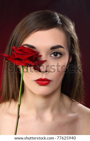 young beautiful woman holding a red rose