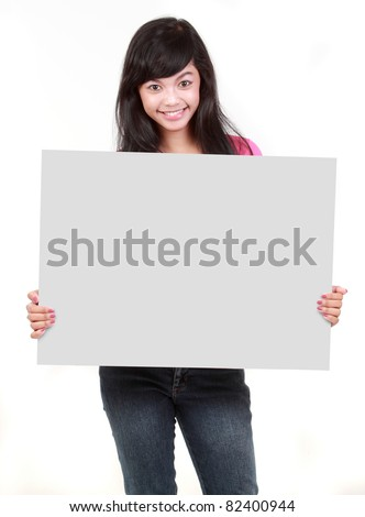 young beautiful woman holding blank white card against white background - stock photo