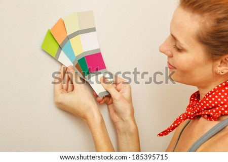 Young beautiful woman holding color palette with color samples. - stock photo