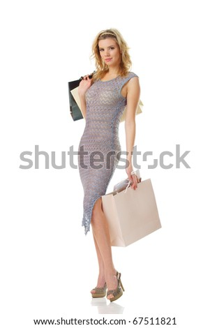 young beautiful woman holding shopping bags isolated on white background