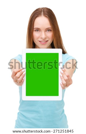 Young beautiful woman holding white tablet with copyspace - isolated on white background. - stock photo