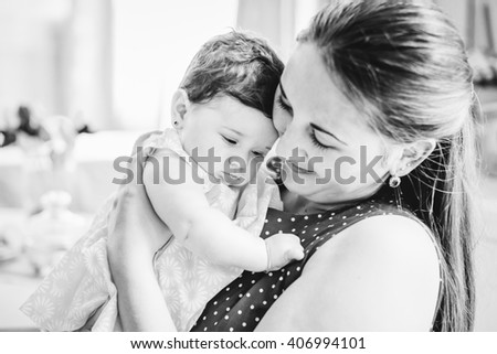 young beautiful woman holds her child