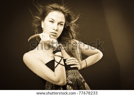 young beautiful woman holds pepper - stock photo