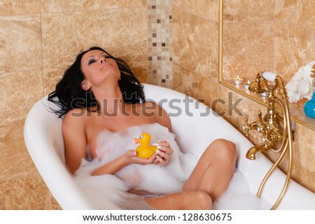 Young beautiful woman in a bathroom. Concept body care. - stock photo