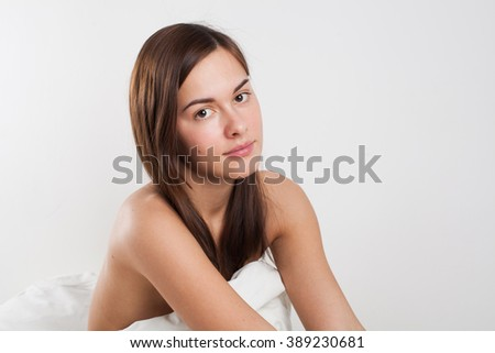 young beautiful woman in a blanket - stock photo