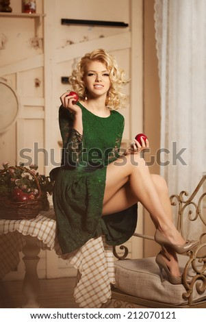 Young beautiful woman in a cafe. Modern trendy blondy girl in restaurant.  - stock photo