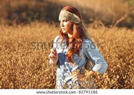 Young Beautiful Woman in a Field During Summertime - stock photo