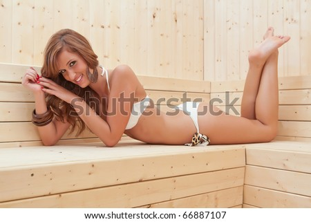 young beautiful woman in a steam room smiling