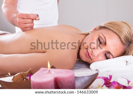 Young Beautiful Woman In An Acupuncture Therapy In A Spa Center - stock photo