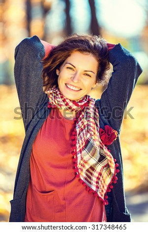 Young beautiful woman in autumn park - stock photo
