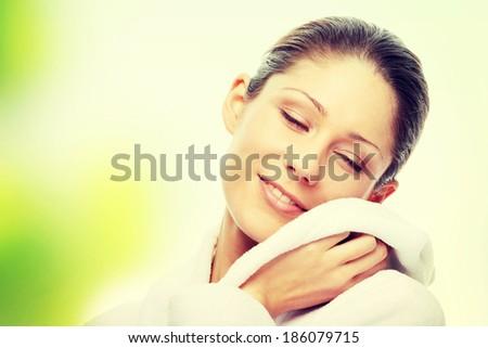 Young beautiful woman in bathrobe - stock photo