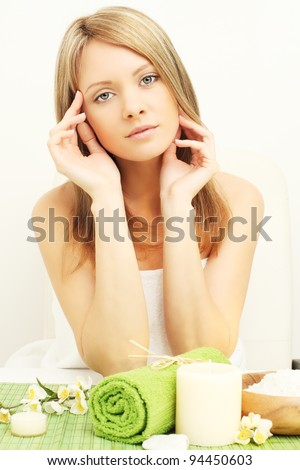 Young beautiful woman in beauty salon - stock photo