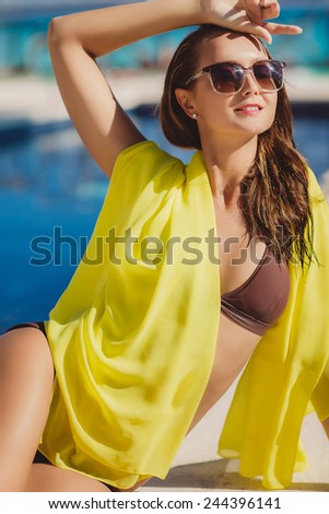 young beautiful woman in bikini on blue ocean background. Happy woman on the tropical beach. woman on beach with tropical suntan in virgin islands. Sexy sandy woman on tropical beach - stock photo