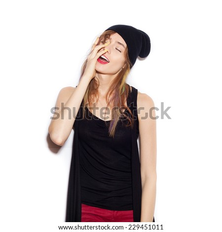 Young beautiful woman in black beanie. Toned. Beautiful Girl opening Mouth. Emotion.  Hairstyle. Makeup.    White background, not isolated - stock photo