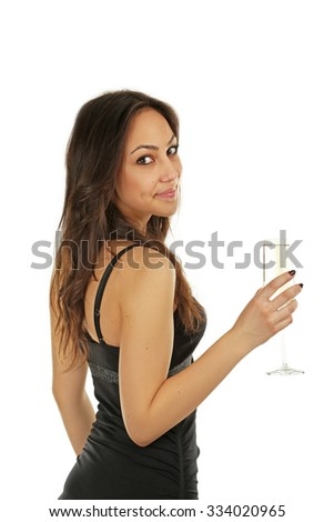 Young beautiful woman in black dress with a glass of champagne - stock photo