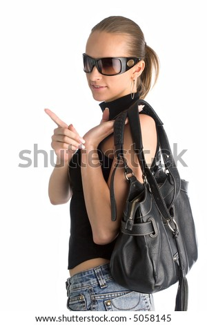 young beautiful woman in black t-shirt, short skirt and sunglasses, with black leather handbag, isolated on white