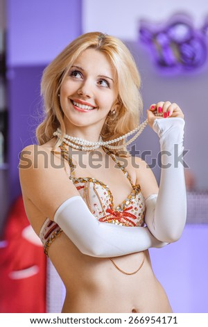 Young beautiful woman in dancing suit laughs. - stock photo