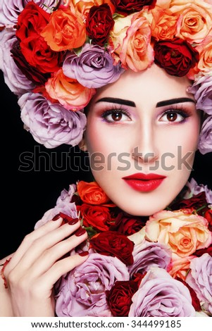 Young beautiful woman in fancy vintage wig and necklace of colorful roses - stock photo