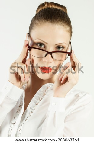 young beautiful woman in glasses - stock photo