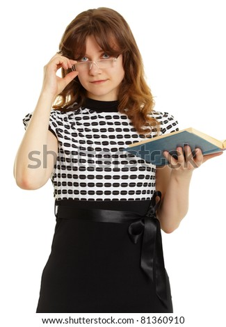 Young beautiful woman in glasses with a book isolated on white background - stock photo