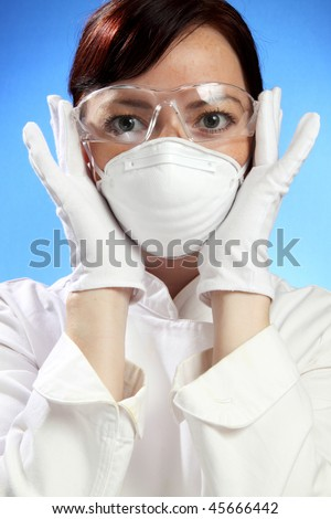Young beautiful woman in gloves - stock photo