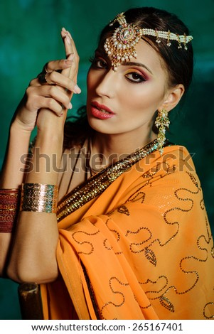 Young beautiful woman in indian costume - stock photo