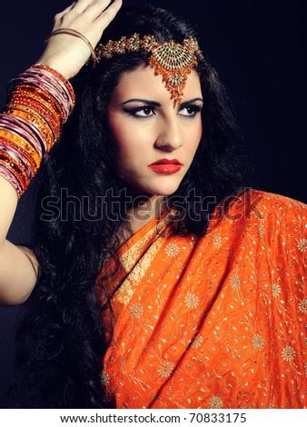 Young beautiful woman in indian traditional sari dress - stock photo