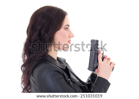 young beautiful woman in leather jacket with gun isolated on white background - stock photo