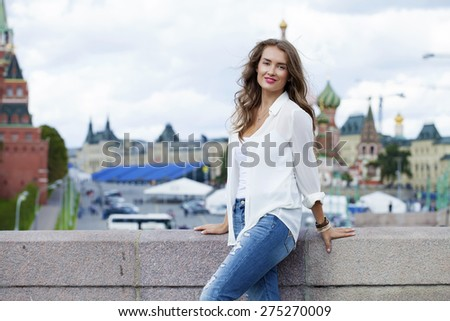 Young beautiful woman in Moscow, Russia - stock photo
